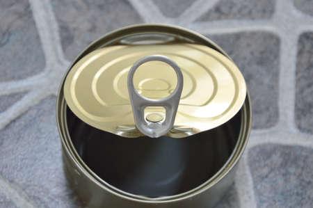 the opener: opener of empty food can Stock Photo