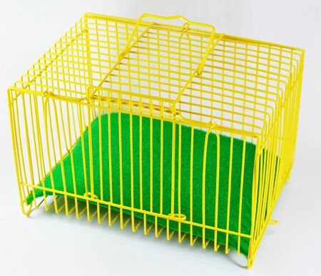 rabbit cage: yellow cage and green sheet for tiny pet