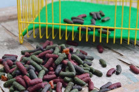 rabbit cage: rabbit food and yellow cage Archivio Fotografico