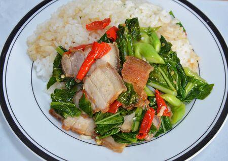 digest: stir-fried Chinese kale with crispy pork on rice