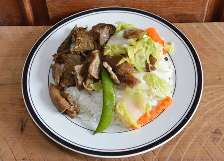 entrails: fried pork entrails with garlic and stir-fried mixed vegetable on rice