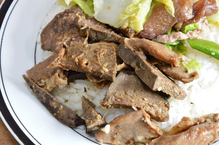 entrails: fried pork entrails with garlic on rice Stock Photo