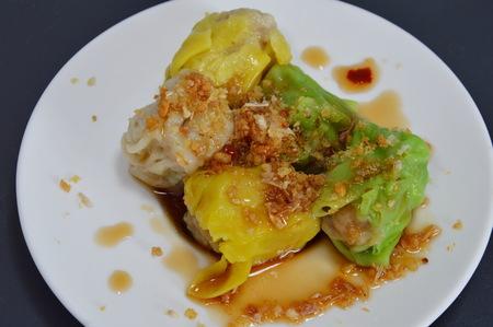pork chop: Chinese dumpling filling pork chop dressing soy sauce on dish Stock Photo
