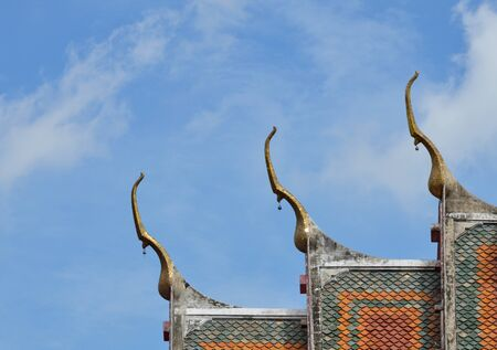 buddhist temple roof: gable apex on Buddhist temple roof Stock Photo