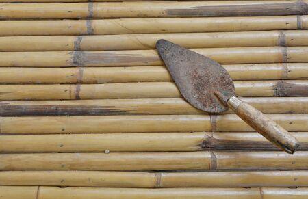trowel: steel trowel on bamboo