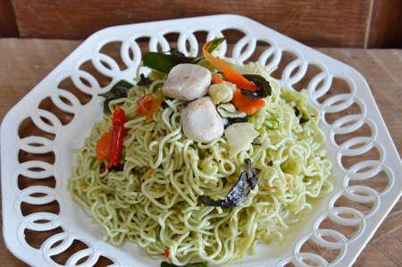 instant noodle: stir-fried vegetarian instant noodle on dish Stock Photo