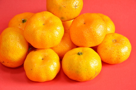 navel: navel orange on red background