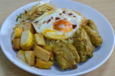 pork rib: boiled curry pork rib and tofu topping fried egg on rice
