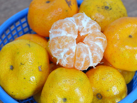 navel orange: navel orange peel out on blue basket