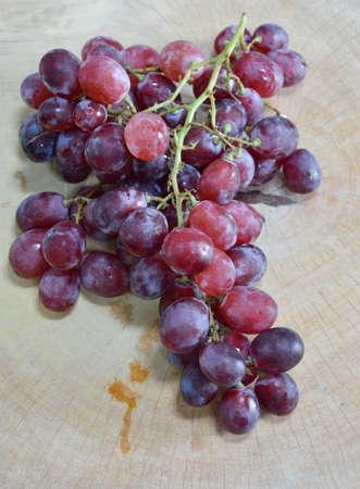 chop: grape on wooden chop block