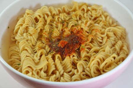monosodium glutamate: instant noodle parboiled in bowl Stock Photo