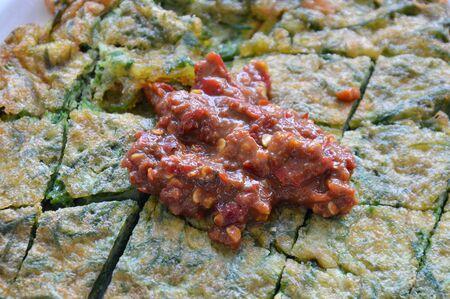 chili sauce: shrimp paste chili sauce on fried egg with climbing wattle Stock Photo