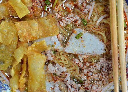 chop stick: egg noodle topping fish line and deep fried dumpling strip
