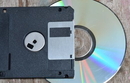 Floppy disk: floppy disk and compact disc on wood board Stock Photo