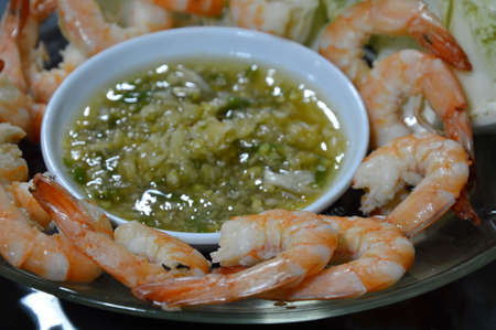 shrimp cocktail: shrimp cocktail and spicy sauce on dish Stock Photo