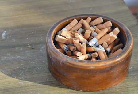 ashtray: cigarette filter in ceramic ashtray