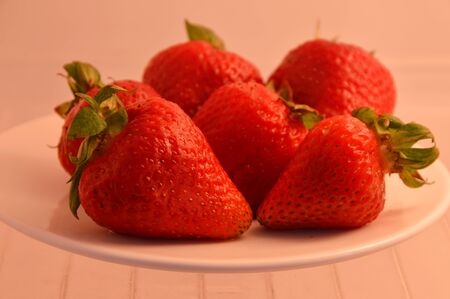 refrigerator: strawberry on dish in refrigerator
