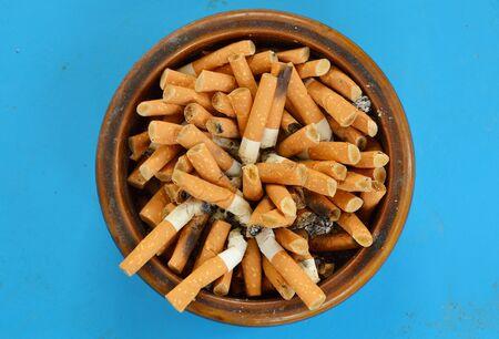 ashtray: cigarette filter in ceramic ashtray