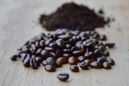 acidity: coffee bean and powder on wooden board
