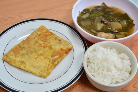 sweet food: stuffed omelets with Chinese vegetable stew to eat with rice