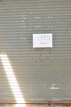 louver: paper sign on iron louver door