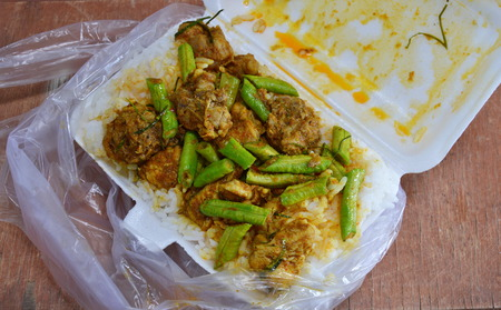 foam box: stir-fried spicy curry with crispy chicken on rice in foam box