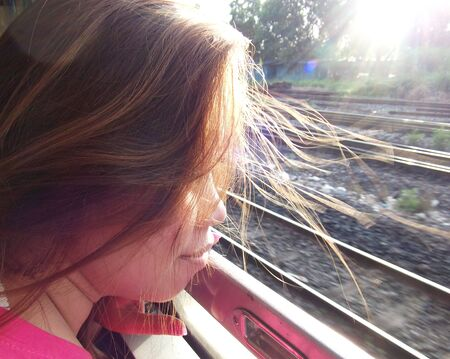 hair wind: woman hair wind blow while traveling on the train