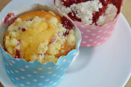 paper cup: blueberry muffin and red velvet in paper cup on dish