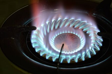 gas stove: fire on gas stove in kitchen