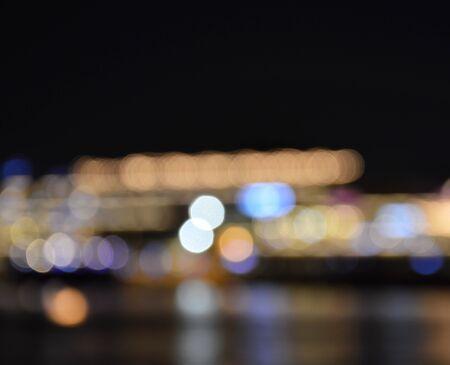 artificial light: blurry of artificial light background on pier