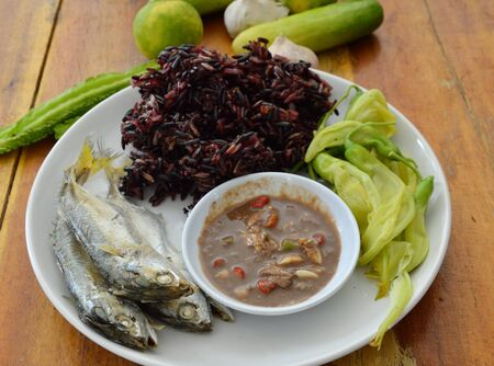thai culture: black sticky rice eat with steam mackerel and shrimp paste sauce Stock Photo