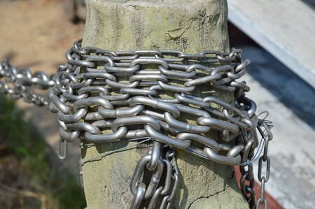 bondage: iron chain roll over wooden pole