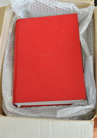 reading materials: red book in brown paper box Stock Photo
