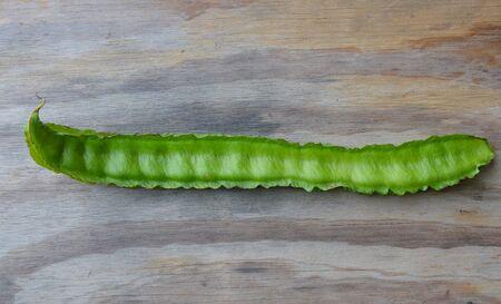 long bean: long wing bean on wooden board