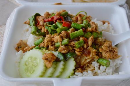 basil  leaf: spicy stir fried chicken with basil leaf on rice in foam box for take home