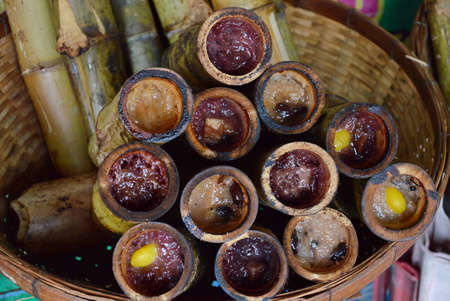 local supply: glutinous rice roasted in bamboo joints on market Stock Photo