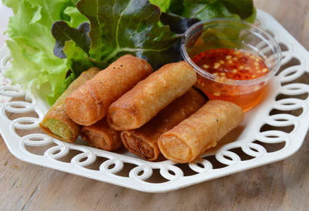 spring roll: deep fried spring roll and sweet chili sauce on dish