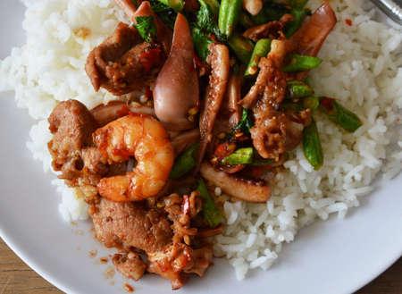 basil  leaf: spicy stir-fried seafood with basil leaf on plain rice