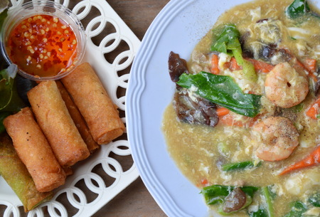 red food: deep fried spring roll and shrimp rice noodle in gravy sauce