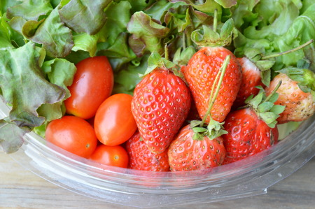 vegetable tray: strawberry and cherry tomato with vegetable on plastic tray