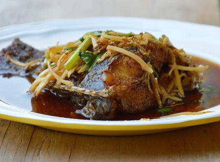 mango fish: deep fried mango fish dressing soy sauce and slice ginger