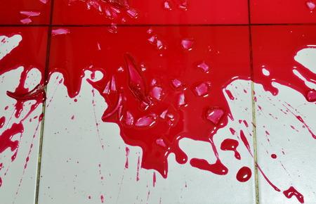 disperse: red blood splash on tile floor