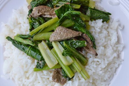 digest: stir-fried Chinese cabbage with pork liver on plain rice Stock Photo