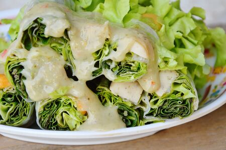 spring roll: Thai fresh spring roll dressing sour sauce on dish Stock Photo