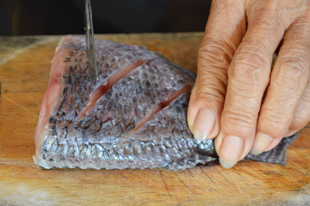 fresh water fish: fresh water fish prepare for cook on wooden chop block Stock Photo