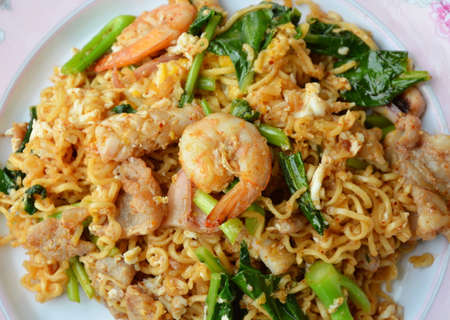 instant noodle: stir fried instant noodle with seafood and Chinese kale Stock Photo