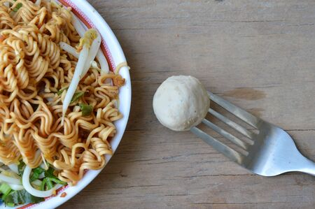 stab: pork ball stab in fork and instant noodle boiled on dish