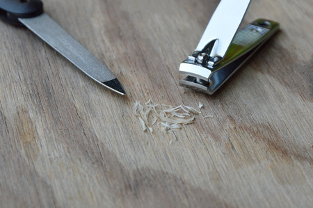 emery: nail clipper and emery file on wooden board