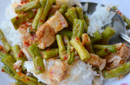 long bean: stir-fried curry yard long bean with fat pork for Thai fast meal Stock Photo