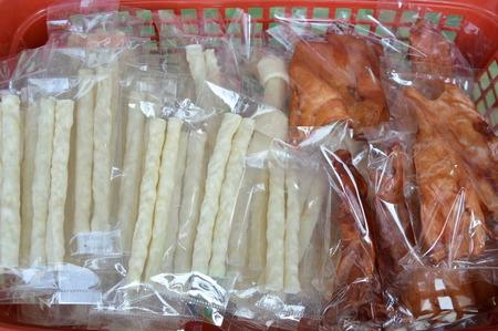 munch: dog snack in plastic bag packing on basket for sale in pet shop